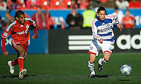 11 April 2009:  FC Dallas midfielder Eric Avila # 12 takes the ball up field as Toronto FC midfielder Amado Guevara #20 gives chase during an MLS game at BMO Field in Toronto between FC Dallas and Toronto FC. The game ended in a 1-1 draw.