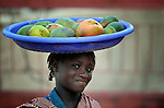 A girl carries mangoes on her head in Timbuktu, a city in northern Mali which was seized by Islamist fighters in 2012 and then liberated by French and Malian soldiers in early 2013.