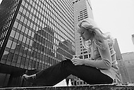 April 15th 1970, Manhattan, New York City, New York, USA. French singer Sylvie Vartan has a quiet moment, writing postcards and letters to friends and family in France while sitting at 6th Avenue and 52nd Street.