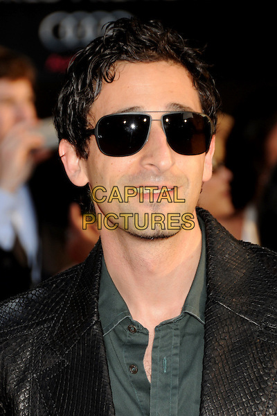 "ADRIEN BRODY .""Iron Man 2"" World Premiere held at the El Capitan Theatre, Hollywood, California , USA, .26th April 2010..arrivals portrait headshot goatee facial hair sunglasses black aviators leather jacket croc snakeskin snake green shirt smiling .CAP/ADM/BP.©Byron Purvis/AdMedia/Capital Pictures."