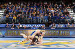 BROOKINGS, SD - NOVEMBER 17: Colten Carlson from South Dakota State University battles with Andrew Shomers from Oklahoma State University during their 157 pound match Saturday night at Frost Arena in Brookings. (Photo by Dave Eggen/Inertia)