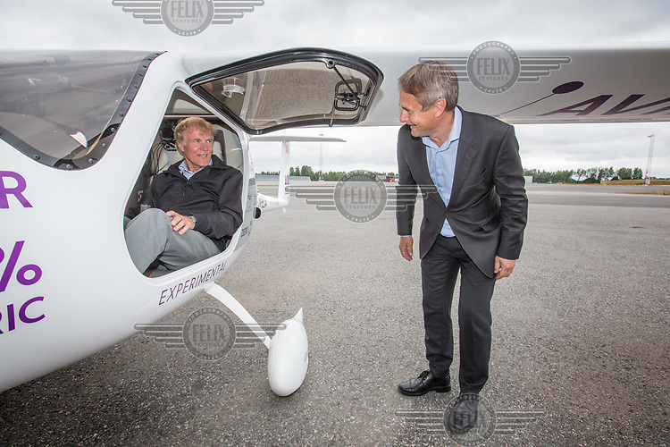 June 18th 2018 saw the first official flight by an electric aircraft in Norway. <br /> <br /> Civil Aviation Authority (Avinor) CEO Dag Falk-Petersen (left) with CEO of Widerøe airline Stein Nilsen.<br /> <br /> The plane is battery operated and signals a focus on more envorinmentally friendly solutions for the fututre. The project is supported by the government, and the project partners are Widerøe, SAS, the Norwegian Association of Air Sports, and climate foundation ZERO.<br /> <br />  © Fredrik Naumann/Felix Features