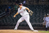 Pawtucket Red Sox starting pitcher Billy Buckner #20 delivers a pitch in the rain during game three of a best of five playoff series against the Empire State Yankees at Frontier Field on September 7, 2012 in Rochester, New York.  Empire State defeated Pawtucket 4-3 to send the series to game four as Pawtucket leads two games to one.  (Mike Janes/Four Seam Images)