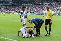 VOETBAL: HEERENVEEN: Abe Lenstra Stadion, 02-09-2012, Eredivisie 2012-2013, SC Heerenveen - Ajax, Eindstand 2-2, Arsenio Valpoort (#29 | SCH), Gianni Zuiverloon (#2 | SCH) zit geblesseerd op het veld, Erik ten Voorde (fysio), scheidsrechter Pol van Boekel, ©foto Martin de Jong