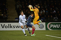 Lorient, France. - Sunday, February 8, 2015:  goalkeeper Sarah Bouhaddi (16) of France grabs a ball as Wendie Renard (2) shields Abby Wambach (20) of the USWNT. France defeated the USWNT 2-0 during an international friendly at the Stade du Moustoir.