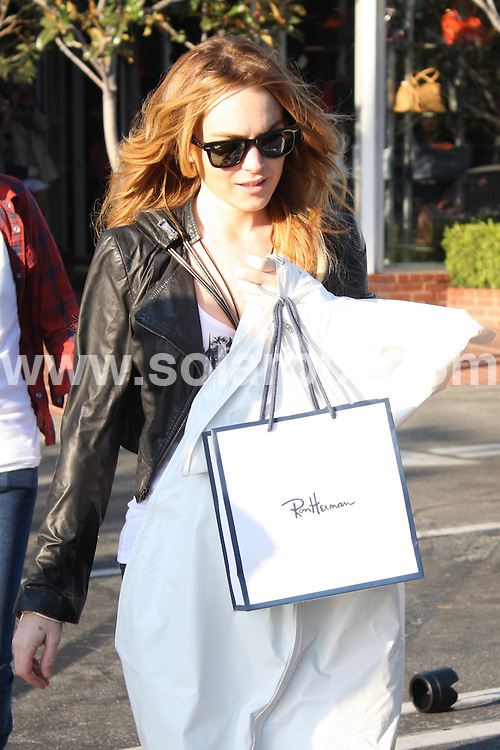 **ALL ROUND PICTURES FROM SOLARPIX.COM**.**WORLDWIDE SYNDICATION RIGHTS**.**NO PUBLICATION IN AUSTRALIA, NEW ZEALAND, DENMARK, GERMANY OR USA**.Lindsay Lohan and Samantha Ronson shop at Fred Segal in West Hollywood where Lindsay purchases a dress for a special evening. Hollywood, California, USA. 20th September 2008..JOB REF: 7424 LAP(HDM)       DATE: 20_09_2008.**MUST CREDIT SOLARPIX.COM OR DOUBLE FEE WILL BE CHARGED* *UNDER NO CIRCUMSTANCES IS THIS IMAGE TO BE REPRODUCED FOR ANY ONLINE EDITION WITHOUT PRIOR PERMISSION*