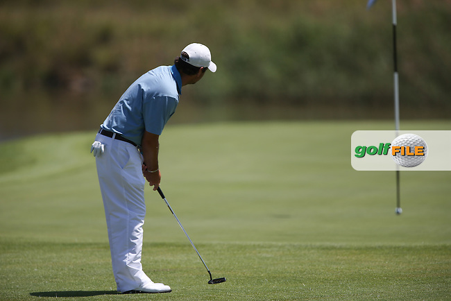Thomas Aiken (RSA) watches his ball clips the pin and lip out during Round Two of The Tshwane Open 2014 at the Els (Copperleaf) Golf Club, City of Tshwane, Pretoria, South Africa. Picture:  David Lloyd / www.golffile.ie