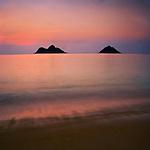 View of Mokulua Islands from Lanikai Beach just before sunrise