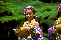 Young hula dancer with ipu (rhythm gourd) and plumeria lei, Lei Day celebration at Hilton Hawaiian Village Hotel