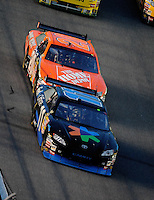 Jul. 5, 2008; Daytona Beach, FL, USA; NASCAR Sprint Cup Series driver Denny Hamlin (11) leads teammate Tony Stewart (20) during the Coke Zero 400 at Daytona International Speedway. Mandatory Credit: Mark J. Rebilas-