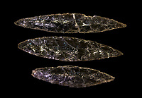 Black obsidian blades. Catalhoyuk Collections. Museum of Anatolian Civilisations, Ankara. Against a black background
