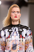 15 February 2014, London, England, UK. A model walks the runway at the Belle Sauvage show during London Fashion Week AW14 at Fashion Scout/Freemasons' Hall.