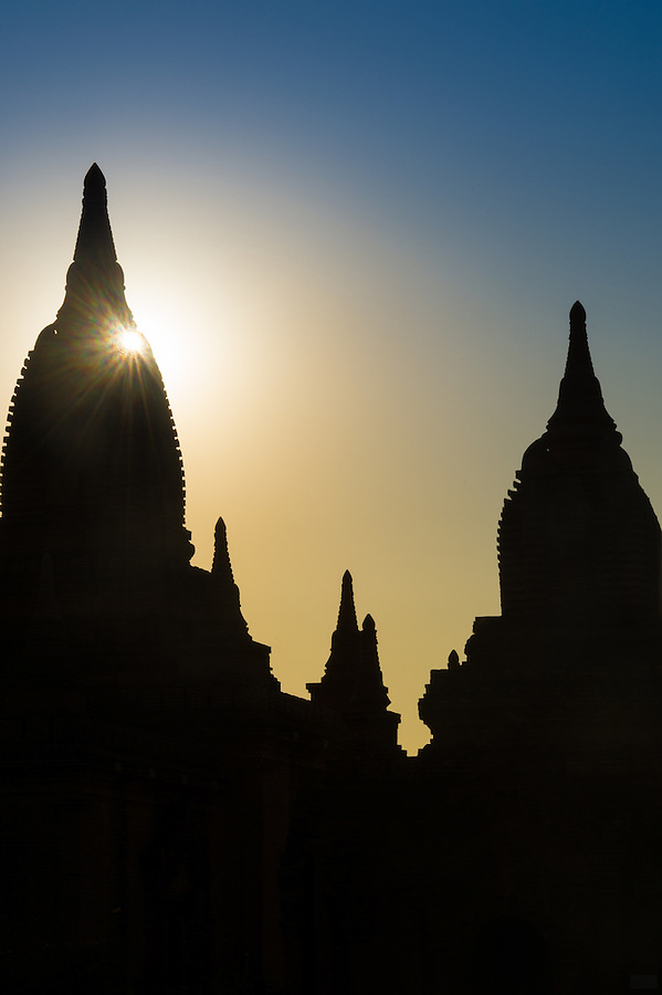 Shilouette of temples over Bagan in Myanmar during twilight.