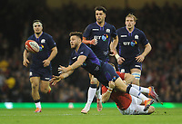 Scotland's Ali Price is tackled by Wales' Gareth Anscombe<br /> <br /> Photographer Ian Cook/CameraSport<br /> <br /> Under Armour Series Autumn Internationals - Wales v Scotland - Saturday 3rd November 2018 - Principality Stadium - Cardiff<br /> <br /> World Copyright &copy; 2018 CameraSport. All rights reserved. 43 Linden Ave. Countesthorpe. Leicester. England. LE8 5PG - Tel: +44 (0) 116 277 4147 - admin@camerasport.com - www.camerasport.com
