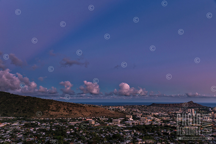 Anti-crepuscular rays over Manoa Valley shortly after sunset, seen from Tantalus, O'ahu.