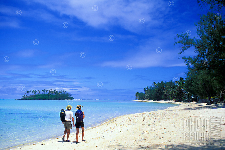 Couple strolling at Muri Beach, Rarotonga, Cook Islands