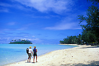 Couple strolling at Muri Beach, Rarotonga, Cook Islands