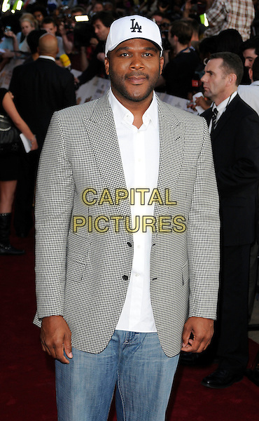 "TYLER PERRY .At a special screening of ""Why Did I Get Married Too?"" at The Ritzy cinema, Brixton, London, England, UK, .21st May 2010..half length black and white gingham checked check jacket blazer shirt cap hat  jeans .CAP/CAN.©Can Nguyen/Capital Pictures."