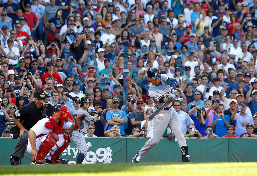Derek Jeter #2 of the New York Yankees records his final hit of his career against the Boston Red Sox in the third inning at Fenway Park on September 27, 2014 in Boston, Massachusetts. (Photo by Jared Wickerham for the New York Daily News)