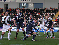 Rocco Quinn (centre) clears in the St Mirren v Ross County Clydesdale Bank Scottish Premier League match played at St Mirren Park, Paisley on 19.1.13.
