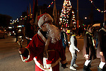 Palestinian man dressed as Santa Claus parades as he attends the Christmas celebrations in the West Bank city of Nablus on Dec. 24, 2012. Photo by Nedal Eshtayah