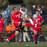 Rutgers University defender Andrew Cuevas (5) and Boston College defender Kevin Mejia (12) battle for the ball. Rutgers University defeated Boston College in penalty kicks after two overtime periods in NCAA Division I tournament action, at Newton Campus Field, November 20, 2011.