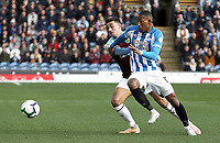 Huddersfield Town's Rajiv van La Parra vies for possession with Burnley's Matthew Lowton<br /> <br /> Photographer Rich Linley/CameraSport<br /> <br /> The Premier League - Burnley v Huddersfield Town - Saturday 6th October 2018 - Turf Moor - Burnley<br /> <br /> World Copyright &copy; 2018 CameraSport. All rights reserved. 43 Linden Ave. Countesthorpe. Leicester. England. LE8 5PG - Tel: +44 (0) 116 277 4147 - admin@camerasport.com - www.camerasport.com