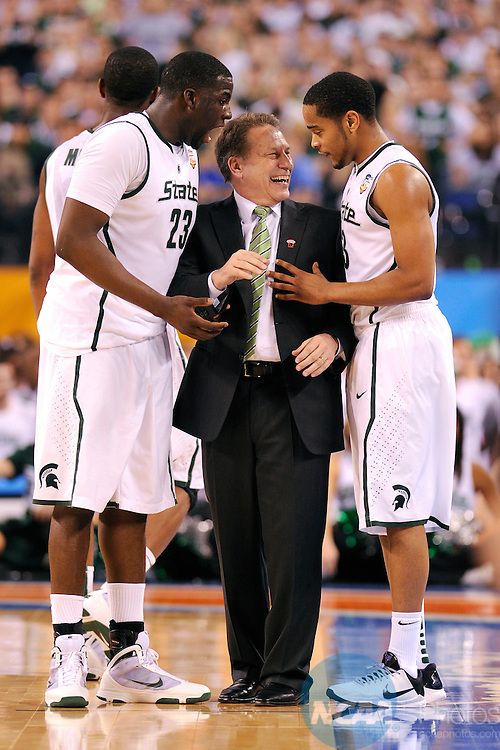 3 APR 2010: Michigan State head coach Tom Izzo shares a quick laugh with his player Chris Allen (3) during the semi final game of the Men's Final Four Basketball Championships held at Lucas Oil Stadium in Indianapolis, IN. Butler University went on to defeat Michigan State University 52-50 to advance to the championship game. Ryan McKee/NCAA Photos
