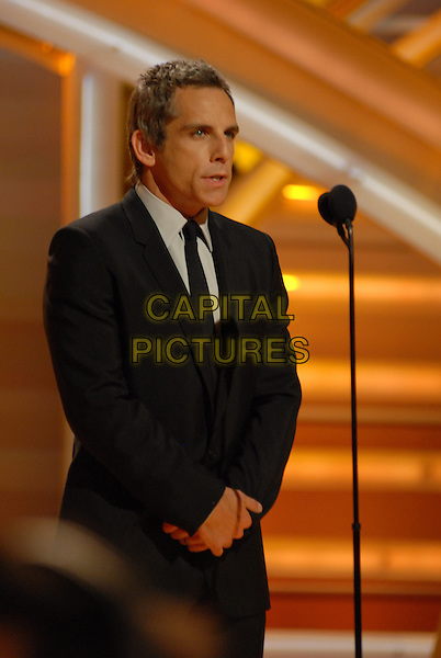 "BEN STILLER.Telecast - 64th Annual Golden Globe Awards, Beverly Hills HIlton, Beverly Hills, California, USA..January 15th 2007. .globes half length stage black suit jacket microphone.CAP/AW.Please use accompanying story.Supplied by Capital Pictures.© HFPA"" and ""64th Golden Globe Awards"""