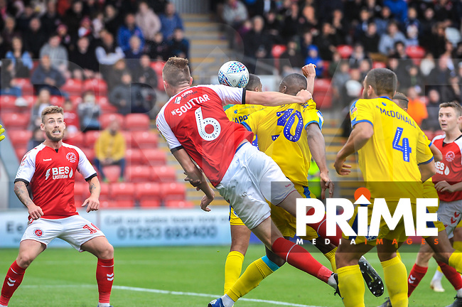 Fleetwood Town's defender Harry Souttar (6) holds off Wimbledon's defender Paul Kalambayi (30) during the Sky Bet League 1 match between Fleetwood Town and AFC Wimbledon at Highbury Stadium, Fleetwood, England on 10 August 2019. Photo by Stephen Buckley / PRiME Media Images.