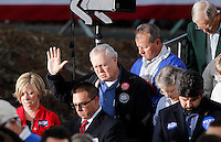 Supporters stood in prayer before Republican Vice Presidential nominee Paul Ryan took the stage during a campaign stop Thursday evening at the Crutchfield Corporation in Albemarle County, Va.