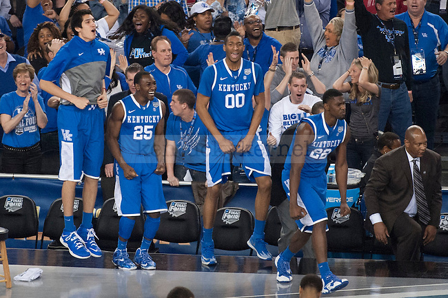 The UK bench celebrates after guard Aaron Harrison (2) makes a 3-pointer during the last 7 seconds during the NCAA Final Four vs. Wisconsin  at the AT&T in Arlington, Tx., on Saturday, April 5, 2014. Photo by Eleanor Hasken | Staff