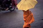 Monk with umbrella, Phnom Penh, Cambodia
