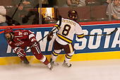 Luke Esposito (Harvard - 9), Kyle Osterberg (UMD - 8) - The University of Minnesota Duluth Bulldogs defeated the Harvard University Crimson 2-1 in their Frozen Four semi-final on April 6, 2017, at the United Center in Chicago, Illinois.