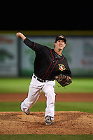 Quad Cities River Bandits pitcher Eric Peterson (37) delivers a pitch during the second game of a doubleheader against the Wisconsin Timber Rattlers on August 19, 2015 at Modern Woodmen Park in Davenport, Iowa.  Quad Cities defeated Wisconsin 8-1.  (Mike Janes/Four Seam Images)