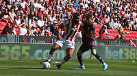 Stoke City's Cameron Carter-Vickers shields the ball from Leeds United's Mateusz Klich<br /> <br /> Photographer Stephen White/CameraSport<br /> <br /> The Premier League - Stoke City v Leeds United - Saturday August 24th 2019 - bet365 Stadium - Stoke-on-Trent<br /> <br /> World Copyright © 2019 CameraSport. All rights reserved. 43 Linden Ave. Countesthorpe. Leicester. England. LE8 5PG - Tel: +44 (0) 116 277 4147 - admin@camerasport.com - www.camerasport.com