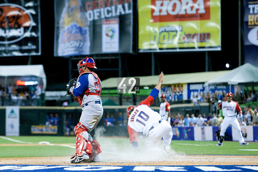 7 March 2009: #10 Michael Aviles slides at home to score during the 2009 World Baseball Classic Pool D match at Hiram Bithorn Stadium in San Juan, Puerto Rico. Puerto Rico wins 7-0 over Panama.