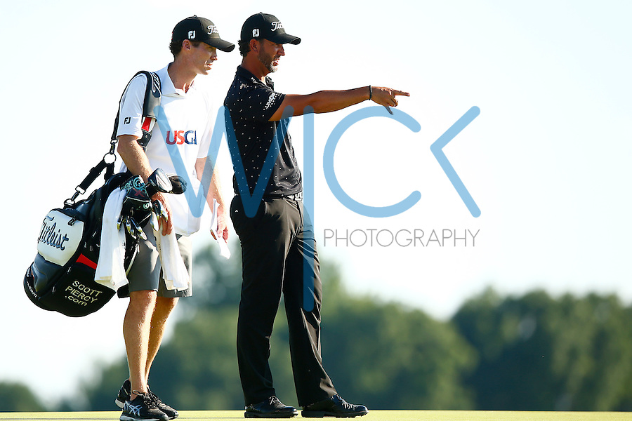 Scott Piercy talks to his caddy on the third green during the 2016 U.S. Open in Oakmont, Pennsylvania on June 17, 2016. (Photo by Jared Wickerham / DKPS)