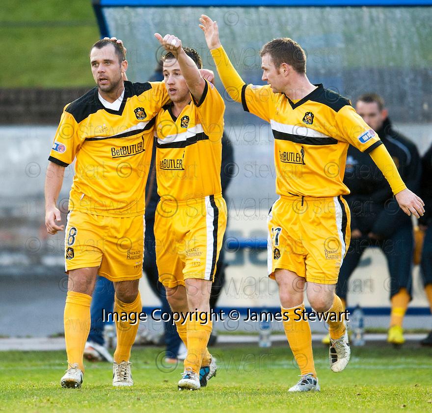 Dumbarton's Mark Gilhaney (centre) celebrates after he scores Dumbarton's goal    ...
