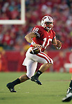 Wisconsin Badgers quarterback Russell Wilson (16) looks for a receiver during an NCAA Big Ten Conference college football game against the Penn State Nittany Lions on November 26, 2011 in Madison, Wisconsin. The Badgers won 45-7. (Photo by David Stluka)