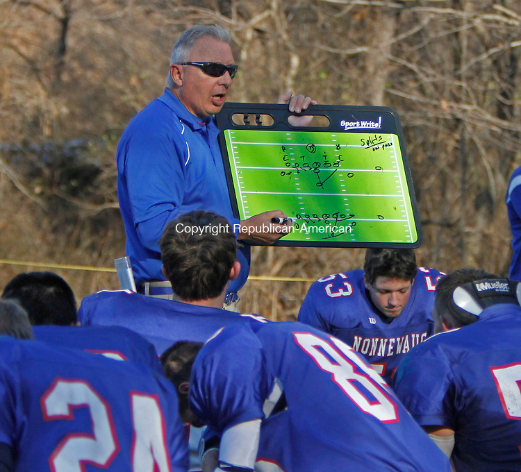 Woodbury, CT111613MK06 Nonnewaug's coach John Oko instructs his players at the half time break during Berkshire League football action against Gilbert / Northwestern Saturday afternoon at Nonnewaug High School in Woodbury.  Gilbert / NorthWest defeated Nonnewaug 27-7. Michael Kabelka / Republican-American