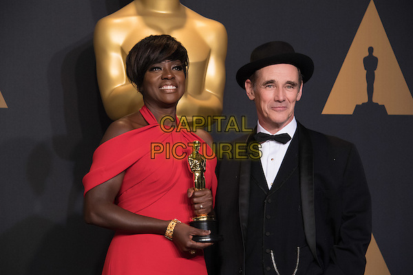 Viola Davis poses backstage, next to Mark Rylance, with the Oscar&reg; for Performance by an actress in a supporting role, for work on &ldquo;Fences&rdquo; during the live ABC Telecast of The 89th Oscars&reg; at the Dolby&reg; Theatre in Hollywood, CA on Sunday, February 26, 2017.<br /> *Editorial Use Only*<br /> CAP/PLF/AMPAS<br /> Supplied by Capital Pictures