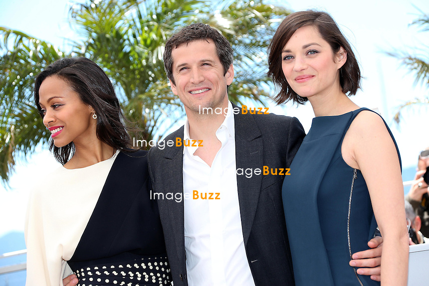 CPE/Actress Zoe Saldana, director Guillaume Canet and actress Marion Cotillard attends the photocall for 'Blood Ties' at The 66th Annual Cannes Film Festival on May 20, 2013 in Cannes, France.
