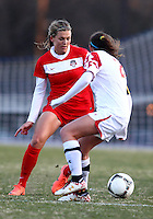 COLLEGE PARK, MARYLAND - April 03, 2013:  Stephanie Ochs (22) of The Washington Spirit knocks the ball past Domenica Hodak (2) of the University of Maryland women's soccer team in a NWSL (National Women's Soccer League) pre season exhibition game at Ludwig Field in College Park Maryland on April 03. Maryland won 2-0.