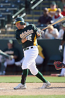 Wes Timmons #67 of the Oakland Athletics bats against the Cleveland Indians in a spring training game at Phoenix Municipal Stadium on March 2, 2011  in Phoenix, Arizona. .Photo by:  Bill Mitchell/Four Seam Images.