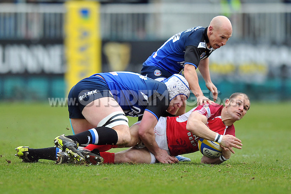 Gordon Ross is double-tackled to ground. Aviva Premiership match, between Bath Rugby and London Welsh on March 30, 2013 at the Recreation Ground in Bath, England. Photo by: Patrick Khachfe / Onside Images