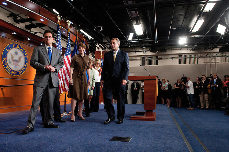 UNITED STATES - JULY 22: From left, House Majority Leader Eric Cantor, R-Va., Rep. Cathy McMorris Rogers, R-Wash., and Speaker of the House John Boehner, R-Ohio, leave the stage after speaking to the media following the House Republican Conference meeting on Friday morning, July 22, 2011. (Photo By Bill Clark/Roll Call)