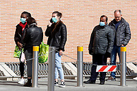 Since last night, long lines have formed out of the supermarkets, due to the restriction that allows few people at a time inside. People queuing with masks<br /> Rome March 10th 2020. Rome the day after the last Minister Council's decree, that extends the restrictions from North of Italy to the entire country to contain Covid-19 Virus. All the shops (restaurants, pubs, and even supermarkets) will have to close at 6 pm. Gathering of people will be forbitten and people will have to maintain the 1 meter security distance. Citizens are furthermore invited to stay at home with the exception of people who have to go to work, to the pharmacy or to the supermarket.<br /> Photo Samantha Zucchi Insidefoto