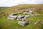 Ruins of stone hut circle in the Neolithic enlcosed area of Grimspound, Dartmoor national park, Devon, England