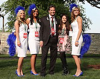 Kendal Hansen poses with his Los Vegas girls in the paddock prior to the Bluegrass Stakes.  April 14, 2012.